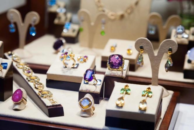 A display of Amethyst and Peridot jewelry from Adore Jewelry & Diamond Center.