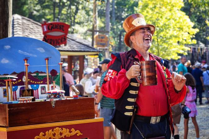 man selling mead at the Renaissance Festival