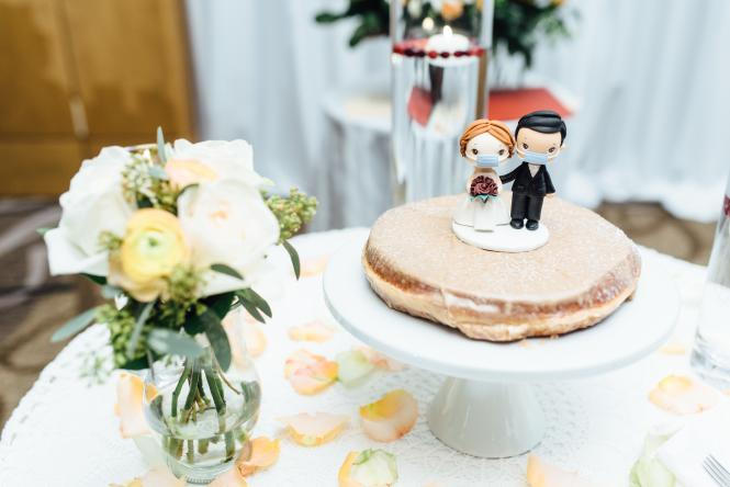 A pandemic bride and groom cake topper on the groom's cake.