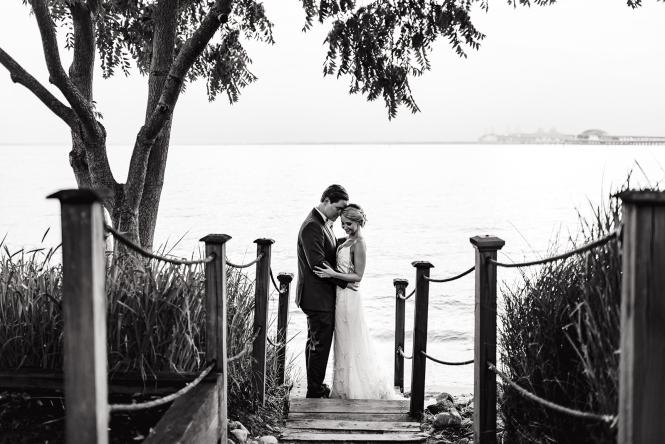 A wedding couple stands waterside at the Chesapeake Bay Beach Club.