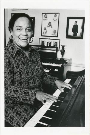 black and white photo of Ernie Mae Miller playing the piano