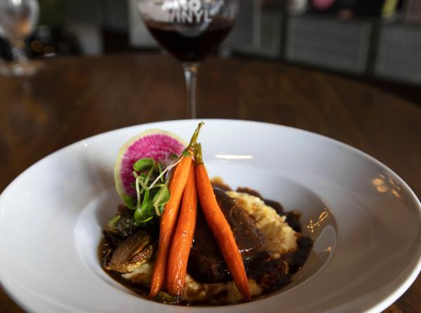A beautiful dish of beef, carrots, and mash at Vino & Vinyl.