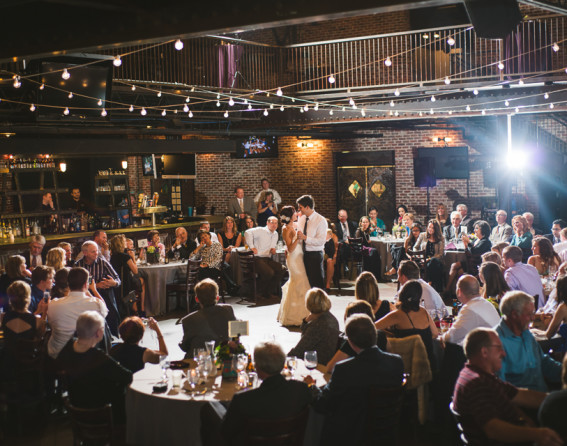 Newlyweds dancing at a wedding at Mile High Station in Denver, Colorado