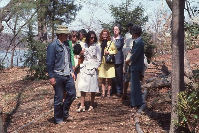 Horticulturalist Tony Dove shows guests around the Garden in 1977.