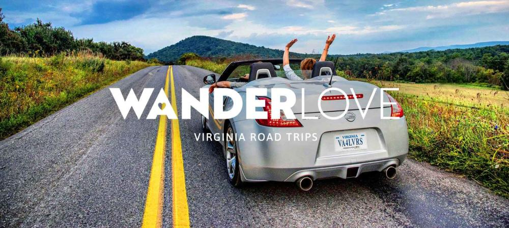 WANDERLove Virginia Road Trips banner of person with their hands in the air while sitting in a convertible driving down a road