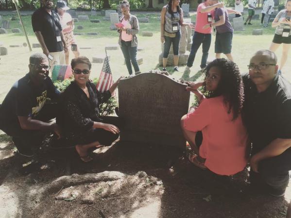 friends gathered at Harriet Tubman's gravesite