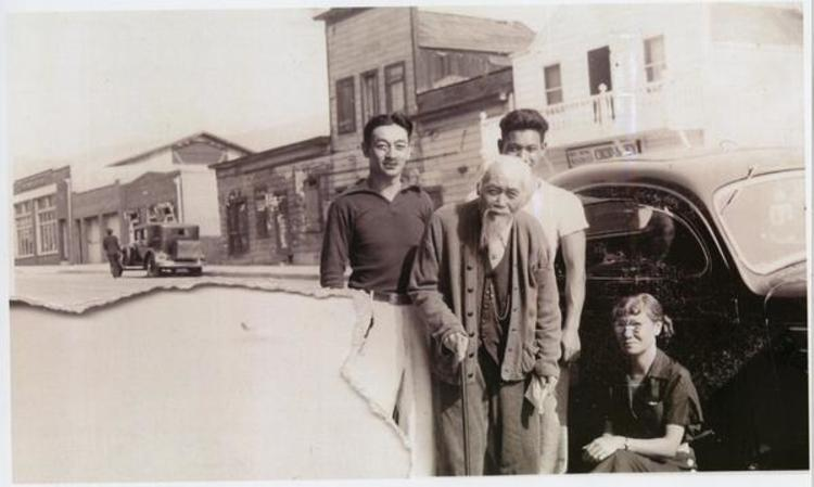 Ah Louis with beard with son Howard Louis and two unidentified people, standing in front of the Ah Louis Store in Chinatown, Palm Street. Mee Heng Low can be seen across the street.