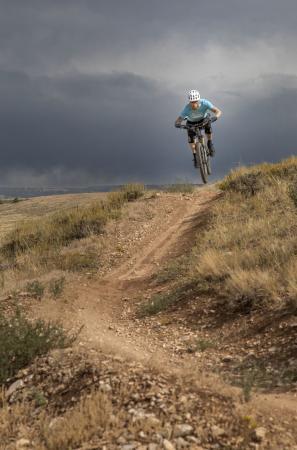 Cresting the hill mountain biking Pilot Hill outside Laramie, Wyoming