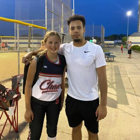 Jordan Peterson of Major Fit Training with one of his clients at her softball game. (Photo courtesy of Major Fit Training Facebook page)
