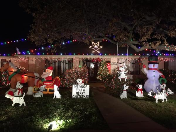 Photo of house with Christmas lights and yard decorations