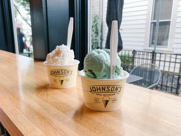 Two Johnson's Ice Cream cups filled with color scoops of ice cream
