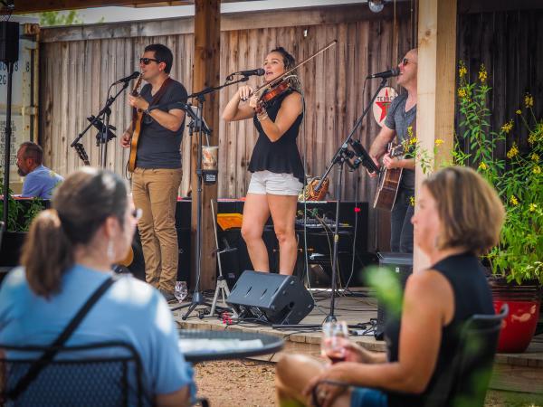 A band performs at an outdoor venue in Fredericksburg, TX