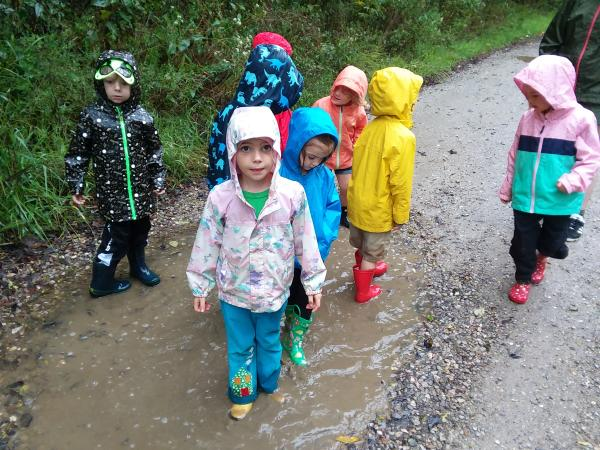Group Of Kids Standing In A Puddle At The Ijams Nature Center