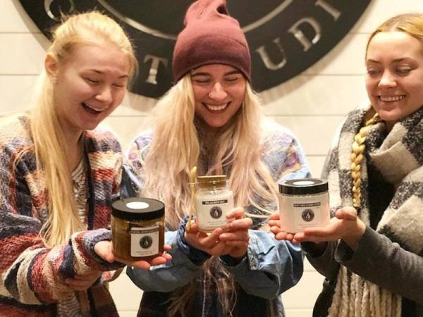 Girls holding their new candles