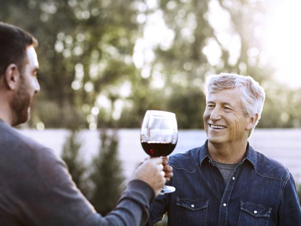 Father and Son Guys Drinking Wine Outside