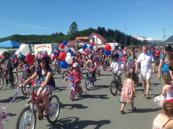 people ride bikes through Valdez, Alaska in summertime