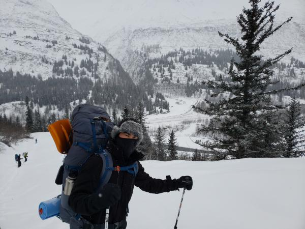 Man in snow-shoes and back-pack
