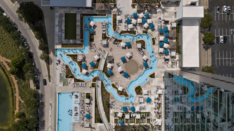 MMH Hotel features a pool and a lazy river in the outline of the state of Texas.