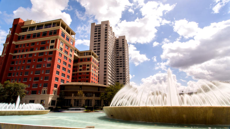 A large water fountain decorates the entrance to Houston's iconic Hotel Zaza