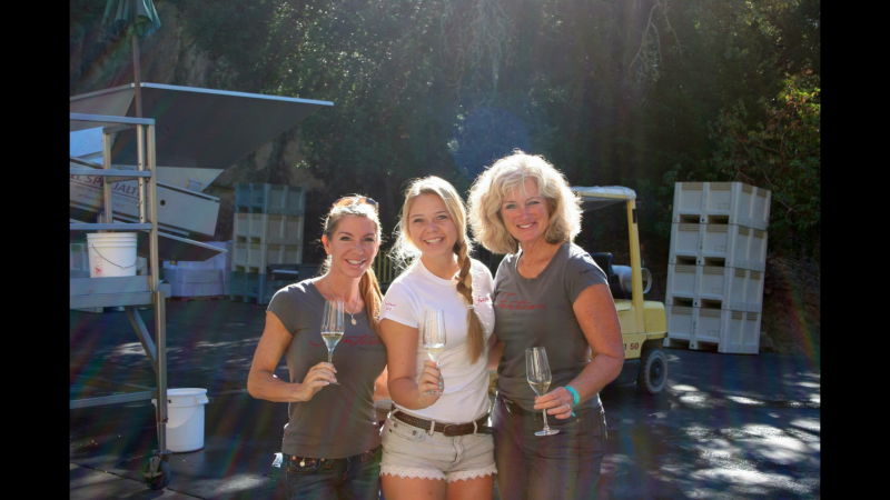 Notable winemakers Heidi Barrett and Chelsea Hoff of Fantesca pose for a group photo.