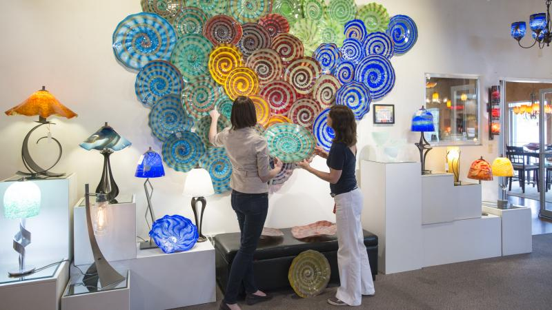 Two women looking at glass platters