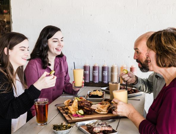 Family eating dinner at Home Team BBQ