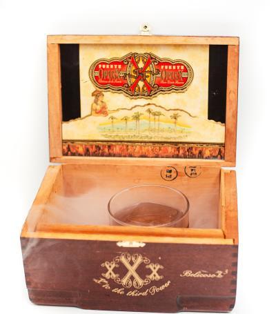 An Old Fashioned drink sitting inside a smoky cigar box at Match Bar
