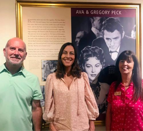 Cecilia Peck with Todd Johnson and Lynell Seabold in front of the Ava & Gregory Peck exhibit