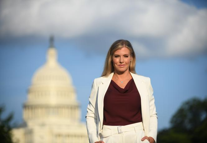Julie Donaldson in front of the Washington Capitol Building.