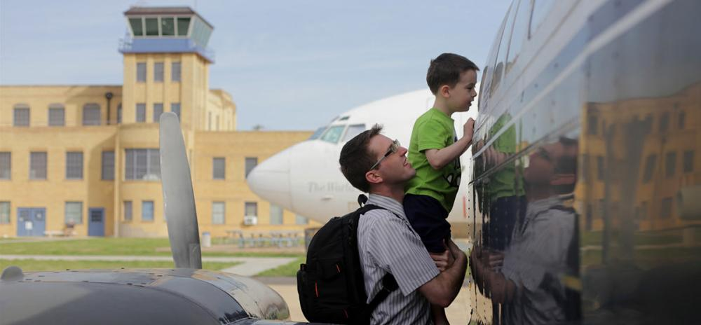 Father and son looking at airplane at Kansas Aviation Museum.