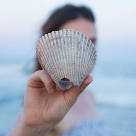Girl Holding Shell