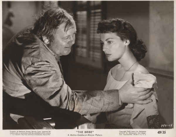 Charles Laughton and Ava Gardner in a scene from the Bribe.