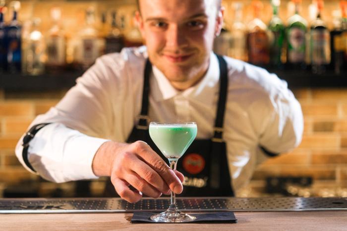 Bartender serving drink