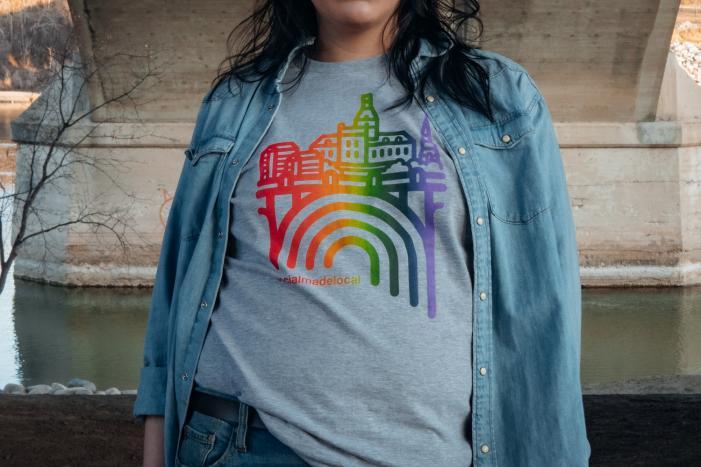 A woman models a pride t-shirt