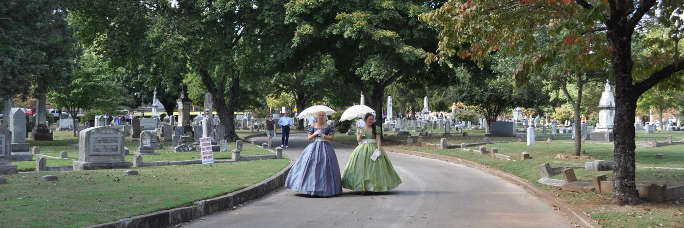 This is a picture of characters dressed up for the Maple Hill Cemetery Stroll.