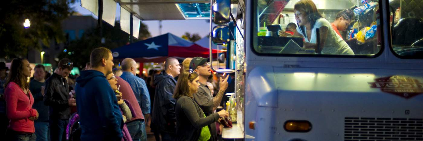 Patrons order from a food truck in Huntsville, AL