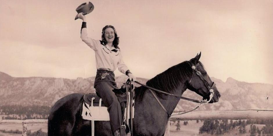 Old photo of a women riding a horse.