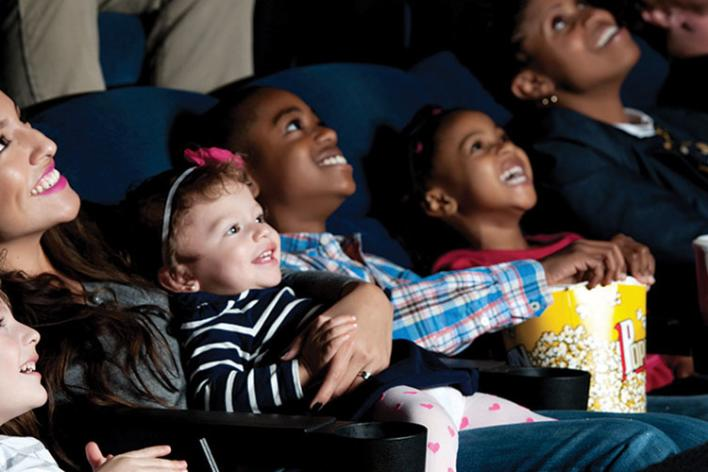 Family With Children Watching In Theater