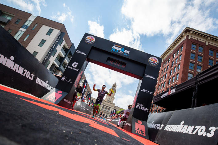 Ironman runner crossing the finish line
