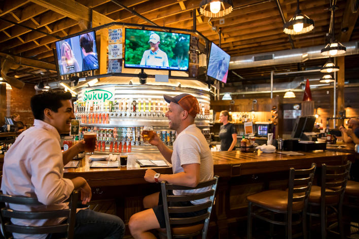 A pair of friends enjoying a beer at Iowa Taproom