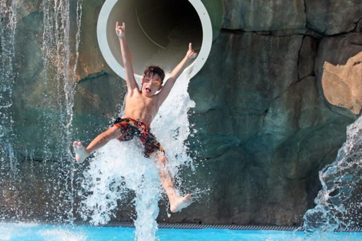 Child Flying Out Of A Waterslide