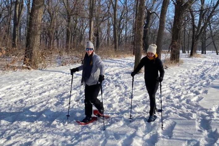 Two People Snowshoeing In Des Moines, IA
