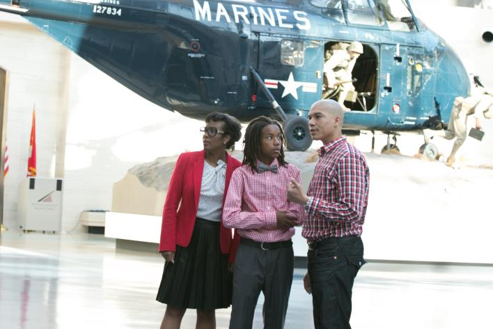 African American family in front of helicopter at Marine Corps Museum