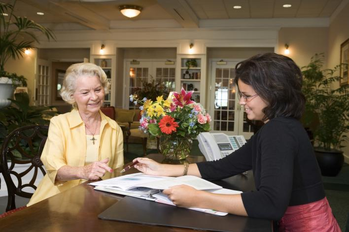 Hotel Concierge assisting female customer
