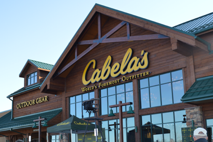 Cabela's World's Foremost Outfitter Storefront, a brown building with hunter green roof and yellow lettering