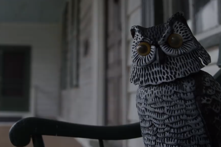 owl figurine on a bench