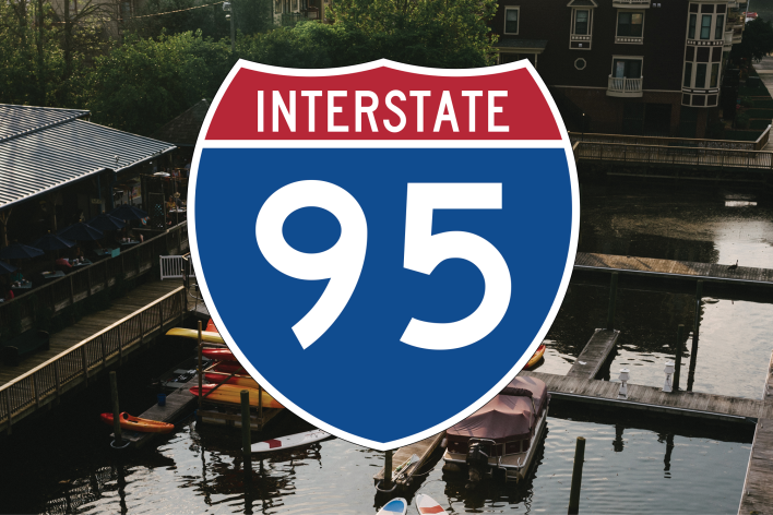 a waterfront with the Interstate-95 Logo on top