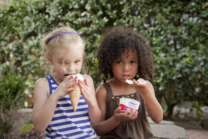 2 girls eating ice cream outside