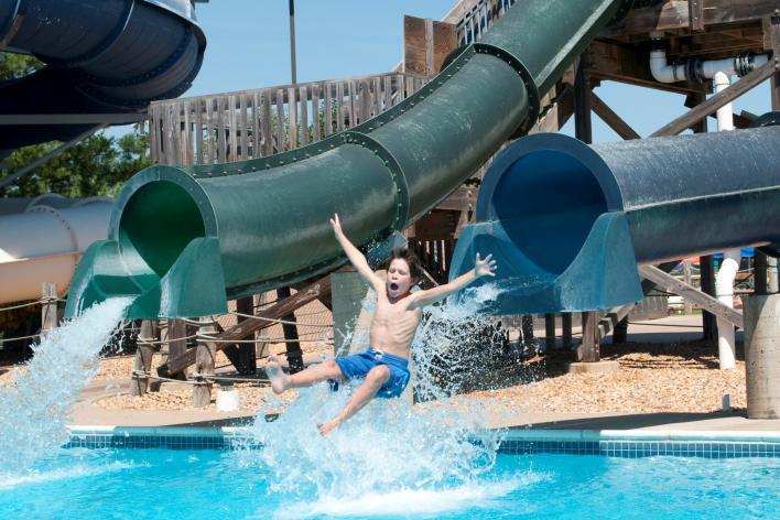 Splashdown Water Park - Boy exiting slide