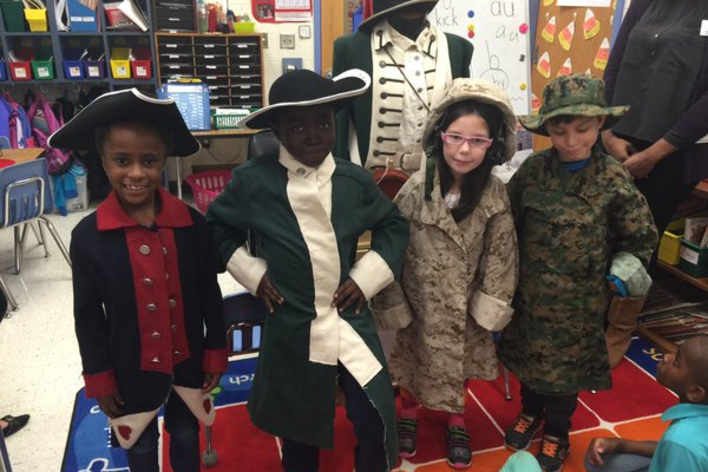 Kids in period costumes from the travel trunks education programs from Marine Corps Museum